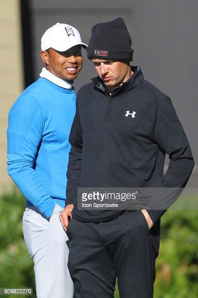 Tiger Woods smiles as he walks by Jordan Spieth on the 13th hole during the first round of the Valspar Championship on March 09 at Westin...