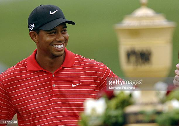 Tiger Woods smiles at the crowd after winning the Bridgestone Invitational at Firestone Country Club August 27, 2006 in Akron, Ohio.
