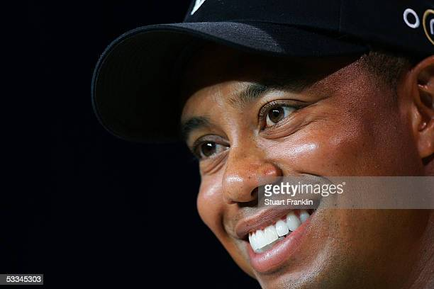 Tiger Woods smiles during a press conference after the second practice round of the 2005 PGA Championship at Baltusrol Golf Club on August 9, 2005 in...