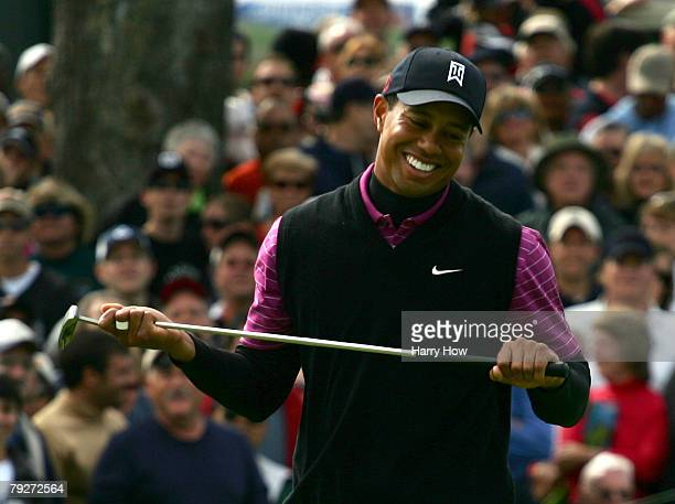 Tiger Woods smiles in reaction to his birdie attempt on the sixth hole during the third round of the Buick Invitational at the Torrey Pines Golf...