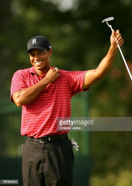 Tiger Woods smiles on the 16th green during the final round of the TOUR Championship the final event of the new PGA TOUR Playoffs for the FedExCup at...