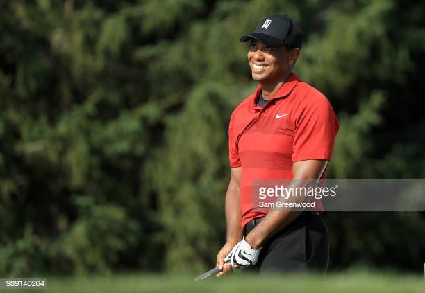 Tiger Woods smiles on the 18th green during the final round of the Quicken Loans National at TPC Potomac on July 1 2018 in Potomac Maryland