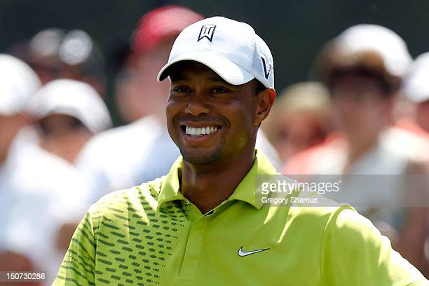 Tiger Woods smiles on the first hole tee box during the third round of The Barclays at the Black Course at Bethpage State Park August 25 2012 in...
