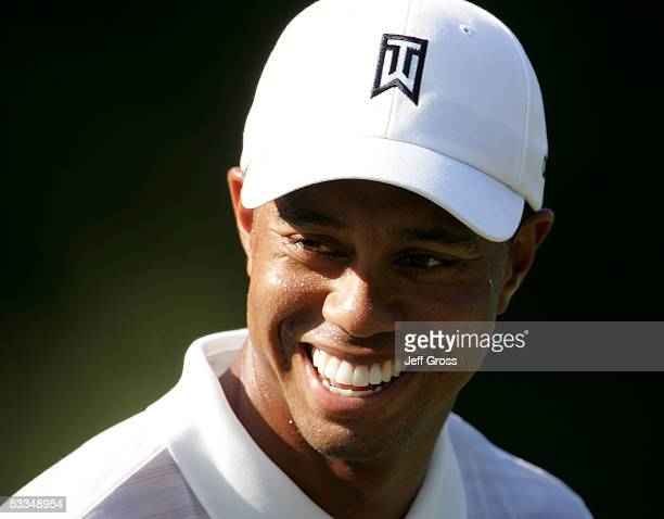Tiger Woods smiles on the range after the third practice round of the 2005 PGA Championship at Baltusrol Golf Club on August 10, 2005 in Springfield,...
