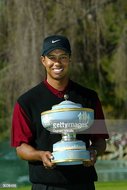 Tiger Woods smiles with the trophy after his 32 victory over Davis Love III during the final round of the WGCAccenture Match Play Championship at the...