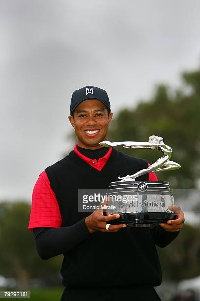 Tiger Woods smiles with the winner's trophy after his 19 under par victory during the final round of the Buick Invitational on January 27 2008 at the...