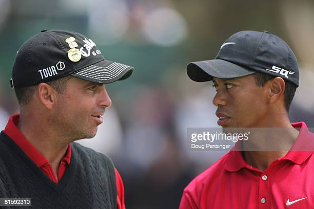 Tiger Woods speaks with runnerup Rocco Mediate after winning on the first sudden death playoff hole during the playoff round of the 108th US Open at...
