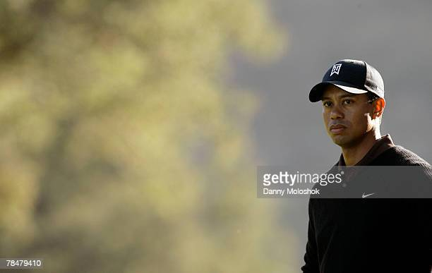 Tiger Woods stands on the 18th fairway on his way to ending the day with a course record 10 under par during the second round of the Target World...