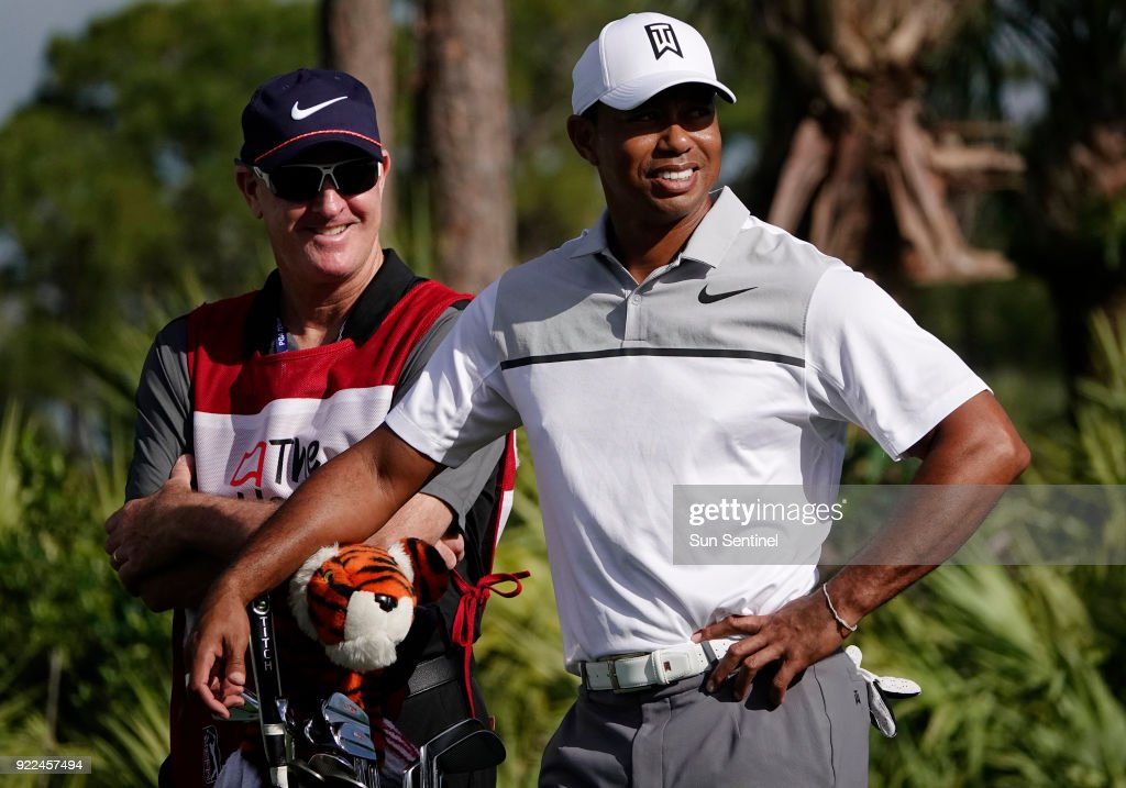 Tiger Woods stands with his caddies Joe LaCava on Wednesday, Feb. 21, 2018 during the Pro-Am round of the Honda Classic at the PGA National in Palm Beach Gardens, Fla.