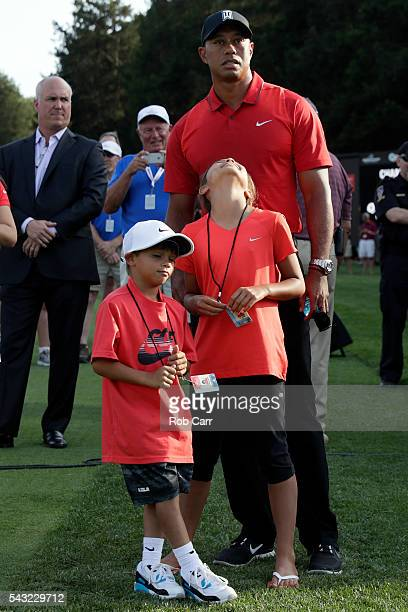 Tiger Woods stands with his children Sam and Charlie after the final round of the Quicken Loans National at Congressional Country Club on June 26...