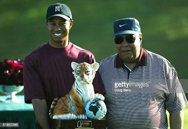 Tiger Woods stands with his father, Earl Woods, during the trophy presentation of the Target World Challenge on December 12, 2004 at Sherwood Country...
