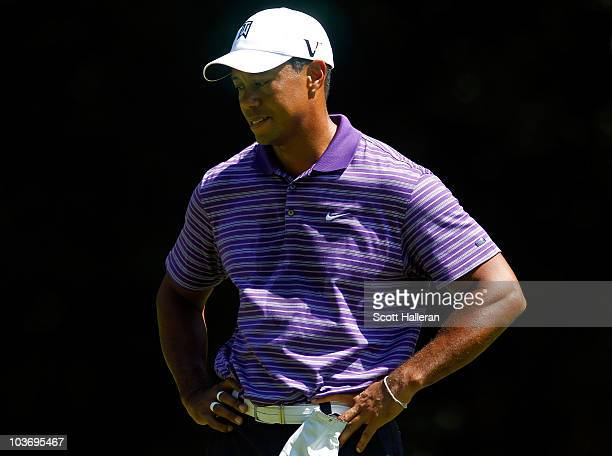 Tiger Woods stands with his head down on the third hole tee box during the third round of The Barclays at the Ridgewood Country Club on August 28...