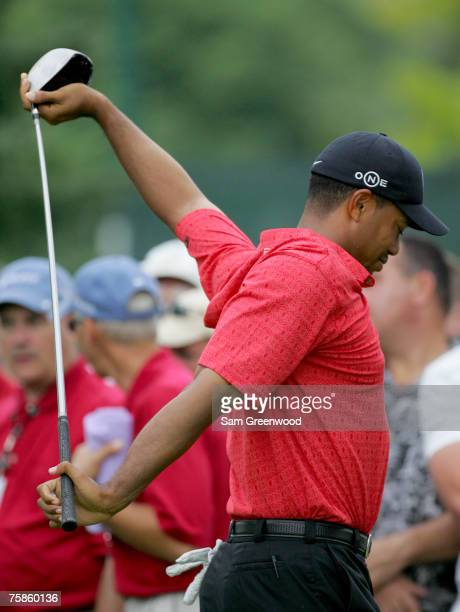 Tiger Woods stretches on the 16th hole during the final round of the Buick Open at Warwick Hills Golf and Country Club in Grand Blanc Michigan on...