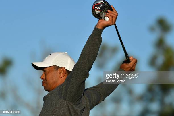 Tiger Woods stretches with his driver and ball in hand during the Pro-Am for the 2019 Farmers Insurance Open at the Torrey Pines Golf Course on...