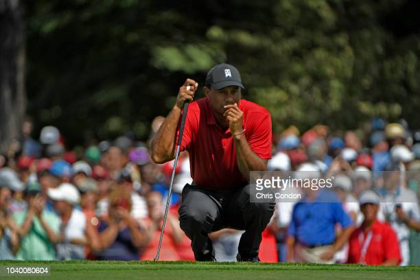 Tiger Woods studies his putt on the fifth green during the final round of the TOUR Championship at East Lake Golf Club on September 23 in Atlanta...