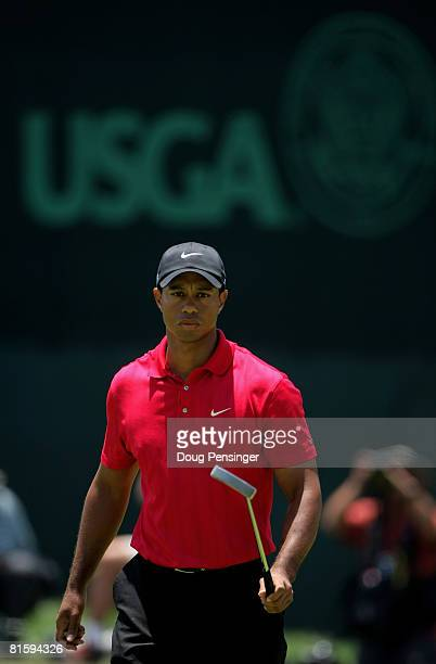 Tiger Woods surveys a putt on the 18th green during the playoff round of the 108th US Open at the Torrey Pines Golf Course on June 16 2008 in San...