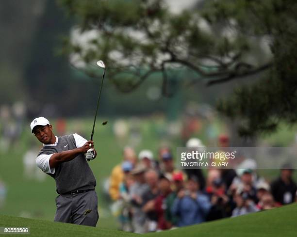 Tiger Woods swings his club during the first day of practice prior to the start of the 2008 Masters Tournament at Augusta National Golf Club on April...