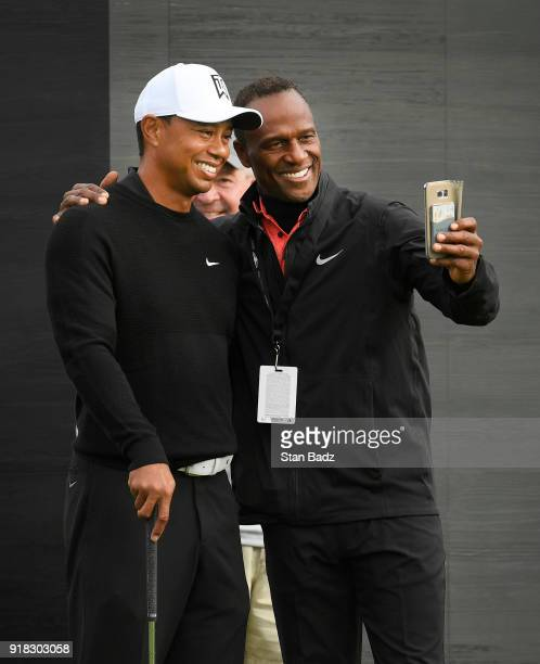 Tiger Woods takes a selfie with a fan on the tenth hole during ProAm round for the Genesis Open at Riviera Country Club on February 14 2018 in...