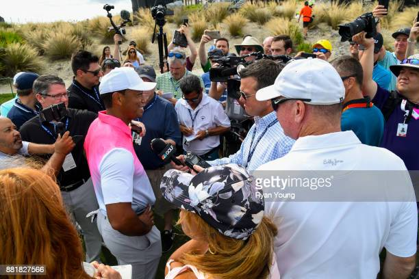Tiger Woods talks to members of the media during practice for the Hero World Challenge at Albany course on November 29 2017 in Nassau Bahamas