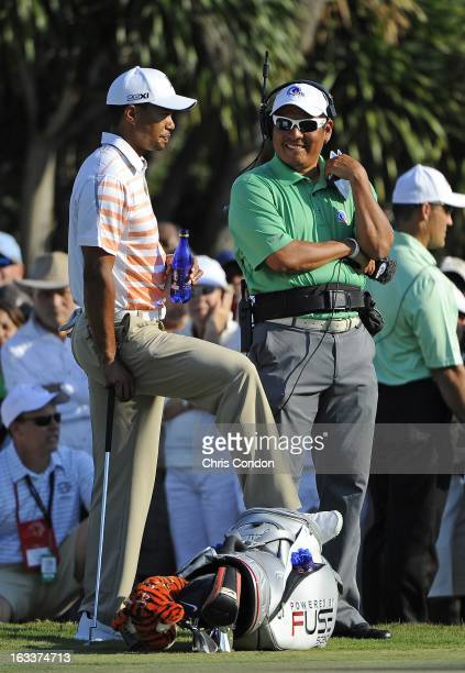 Tiger Woods talks to Notah Begay III on the 13th hole during the second round of the World Golf ChampionshipsCadillac Championship at TPC Blue...