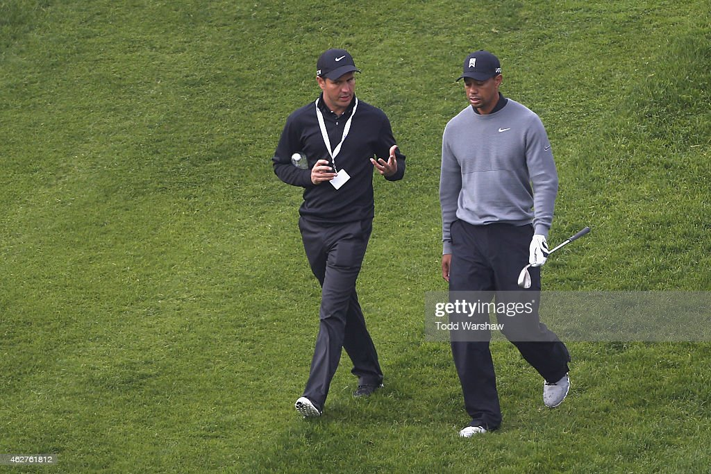 Tiger Woods (R) talks to swing instructor Chris Como on the third hole of the North Course during the Farmers Insurance Open Pro Am at Torrey Pines Golf Course on February 4, 2015 in San Diego, California.
