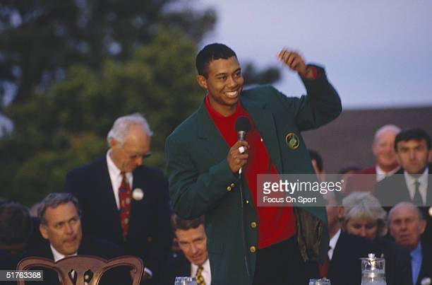 Tiger Woods talks to the press after recieving his Green Jacket for winning the Masters Tournament at the Augusta National Golf Club on April 13 1997...