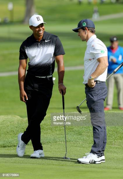 Tiger Woods talks with Mark Wahlberg during the ProAm of the Genesis Open at the Riviera Country Club on February 14 2018 in Pacific Palisades...
