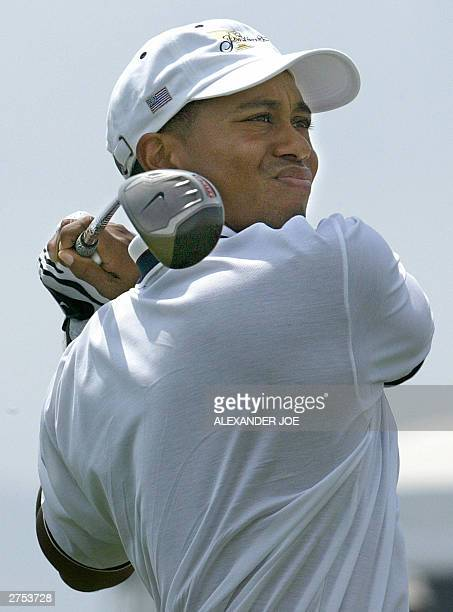 Tiger Woods tees off 22 November 2003 on the seventh hole on the third day of the President's Cup in George South Africa Vijay Singh and Retief...