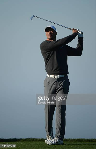 Tiger Woods tees off during the Zurich ProAm the Farmers Insurance Open at Torrey Pines Golf Course on January 22 2014 in La Jolla California