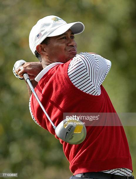 Tiger Woods tees off on during the second round four ball matches for The Presidents Cup on September 28 at The Royal Montreal Golf Club in Montreal,...
