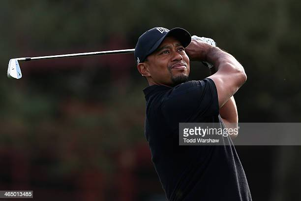 Tiger Woods tees off on the 11th hole during the third round of the Farmers Insurance Open on Torrey Pines South on January 25 2014 in La Jolla...
