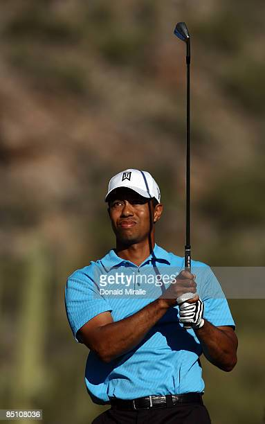 Tiger Woods tees off on the 16th hole en route to a 3 2 victory over Brendan Jones during the first round of the Accenture Match Play Championships...