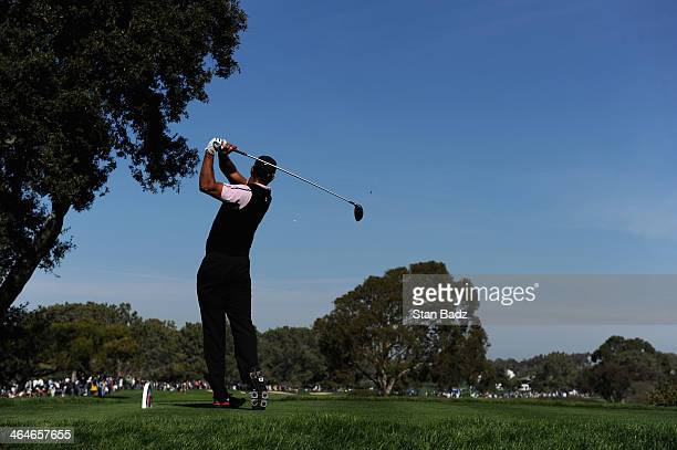 Tiger Woods tees off on the 6th hole during the first round of the Farmers Insurance Open on Torrey Pines South on January 23, 2014 in La Jolla,...
