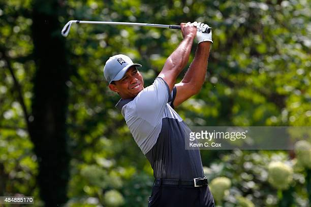 Tiger Woods tees off on the eighth hole during the third round of the Wyndham Championship at Sedgefield Country Club on August 22, 2015 in...