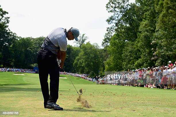 Tiger Woods tees off on the third hole during the third round of the Wyndham Championship at Sedgefield Country Club on August 22 2015 in Greensboro...