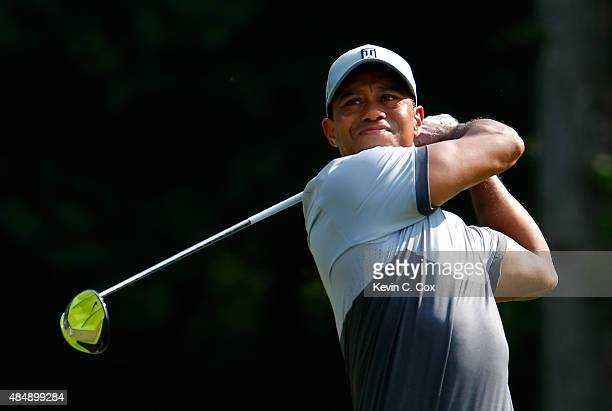 Tiger Woods tees off the 14th hole during the third round of the Wyndham Championship at Sedgefield Country Club on August 22 2015 in Greensboro...