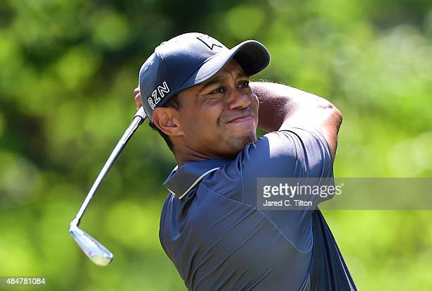 Tiger Woods tees off the eighth hole during the second round of the Wyndham Championship at Sedgefield Country Club on August 21 2015 in Greensboro...