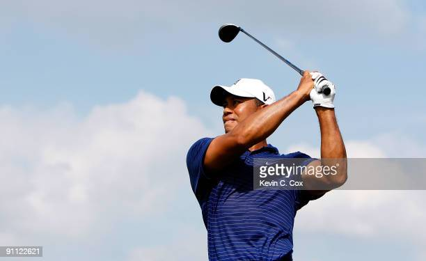 Tiger Woods tees off the seventh hole during the first round of THE TOUR Championship presented by CocaCola the final event of the PGA TOUR Playoffs...