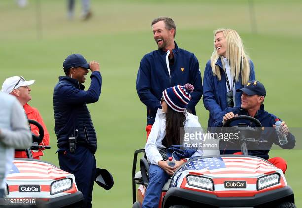 Tiger Woods the United States Team Captain exchanges hats with Webb Simpson watching the matches on the course during the afternoon fourball matches...