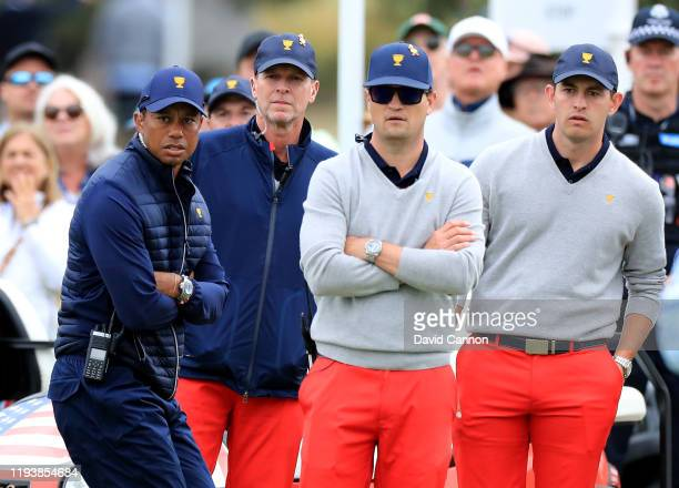 Tiger Woods the United States Team Captain watches with Steve Stricker Zach Johnson and Patrick Cantlay on the course during the afternoon fourball...