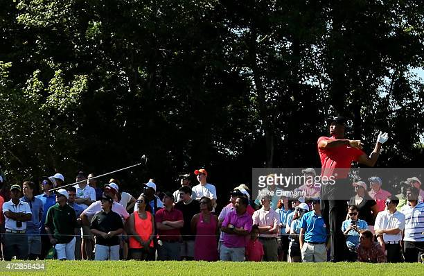 Tiger Woods throws his driver as he plays his shot from the seventh tee during the final round of THE PLAYERS Championship at the TPC Sawgrass...