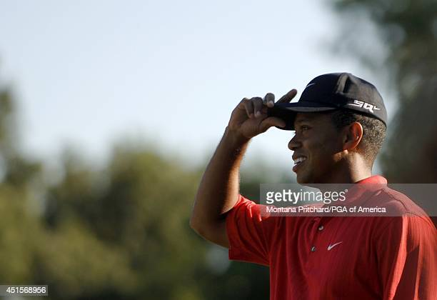 Tiger Woods tipping his hat to his fans after making his putt to win on green during round 4 of the 88th PGA Championship in Medinah Illinois Sunday...