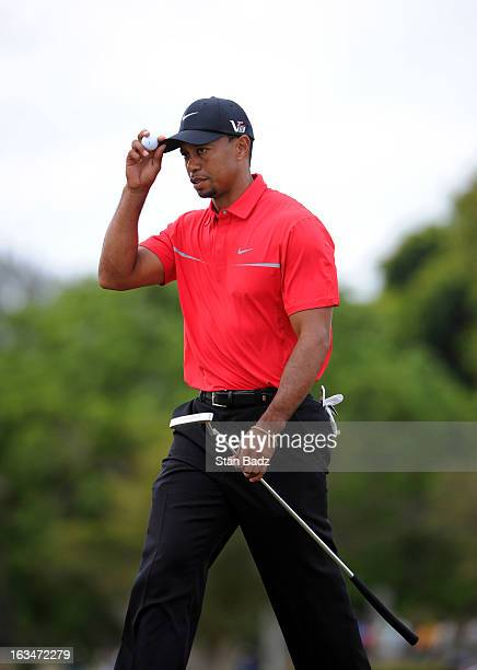 Tiger Woods tips his cap on the fourth hole during the final round of the World Golf ChampionshipsCadillac Championship at TPC Blue Monster at Doral...