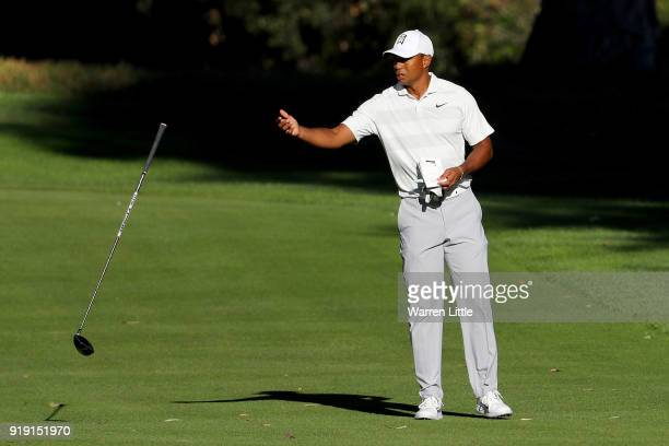 Tiger Woods tosses his club after his shot on the 13th hole during the second round of the Genesis Open at Riviera Country Club on February 16 2018...