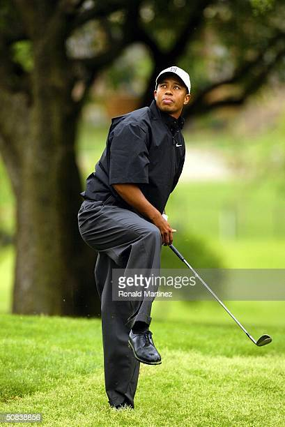 Tiger Woods tries to keep his balance after hitting out of the rough on the 15th hole during the second round of the EDS Byron Nelson Championship on...