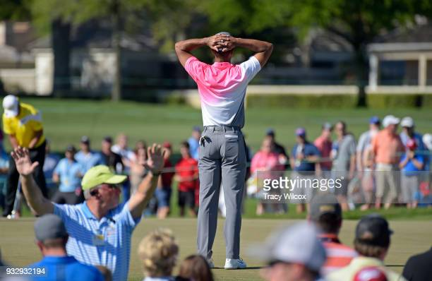 Tiger Woods waits at hole No 13 during the second round of the Arnold Palmer Invitational presented by MasterCard at Bay Hill Club and Lodge on March...