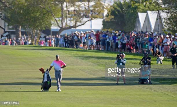 Tiger Woods waits at hole No 18 during the second round of the Arnold Palmer Invitational presented by MasterCard at Bay Hill Club and Lodge on March...