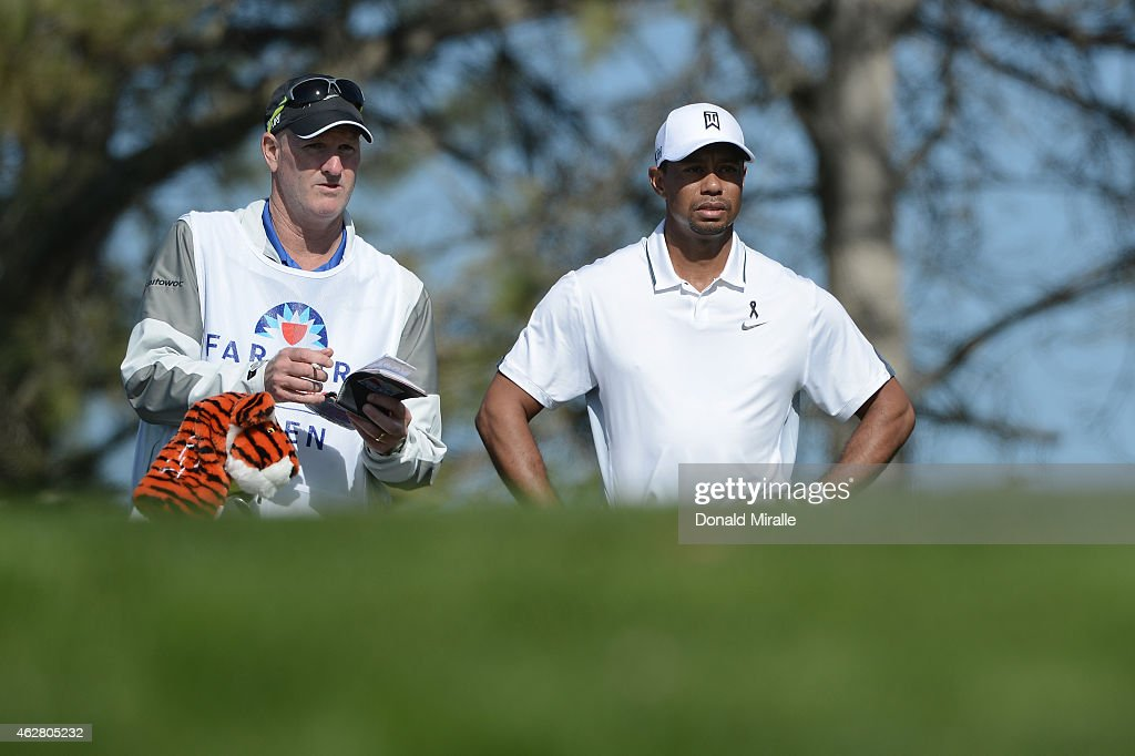 Tiger Woods waits to play his tee shot on the 17th hole of the north course during the first round of the Farmers Insurance Open at Torrey Pines Golf Course on February 5, 2015 in La Jolla, California.