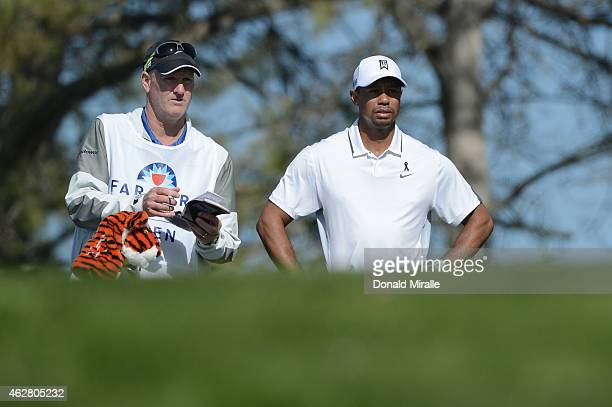 Tiger Woods waits to play his tee shot on the 17th hole of the north course during the first round of the Farmers Insurance Open at Torrey Pines Golf...