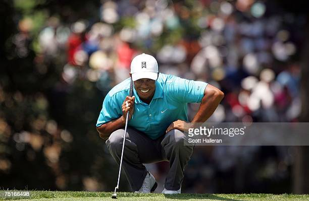 Tiger Woods waits to putt on the ninth green during the second round of the ATT National at Congressional Country Club on July 6 2007 in Bethesda...